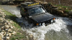 Nissan Patrol and Range Rover in deep water